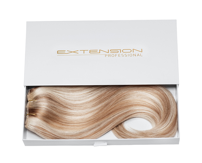 Clip-in hair extensions in box packaging